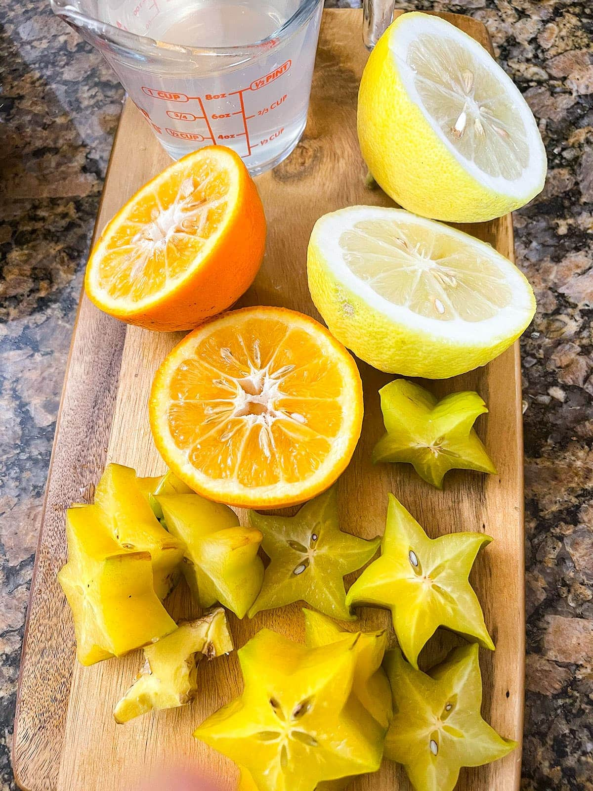ingredients for star fruit juice chopped on a cutting board