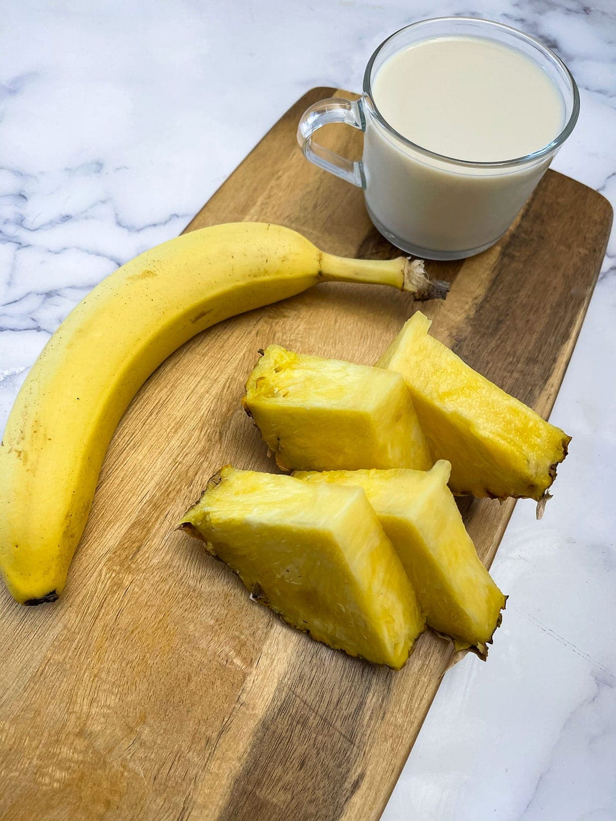 ingredients for pineapple banana smoothie, pineapple, banana and almond milk
