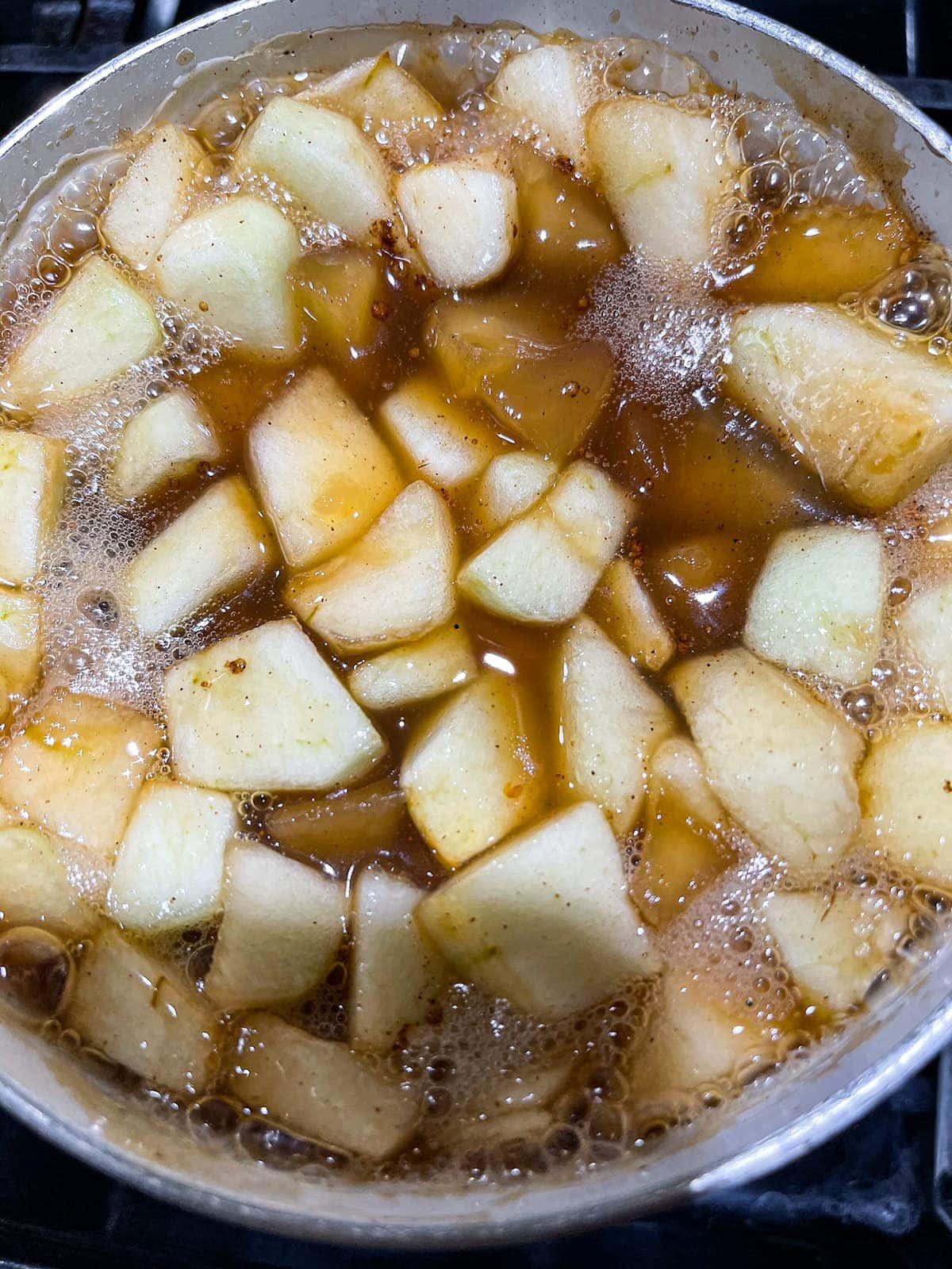 apple pie filling cooking in a pot