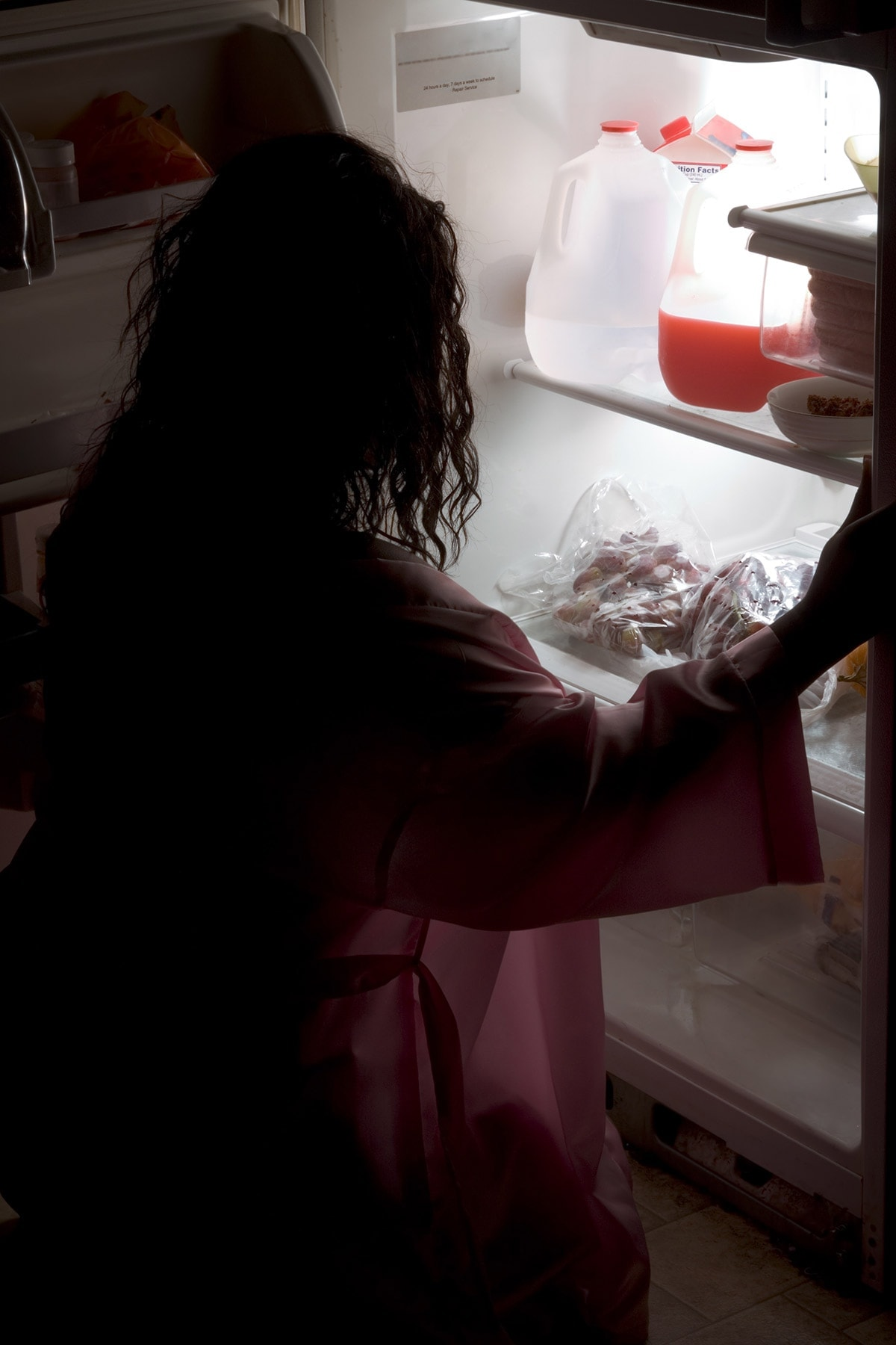 late night eating female in the dark, looking in the refrigerator