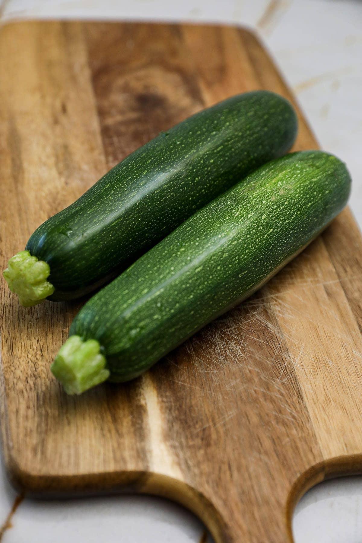 zucchini on wooden cutting board