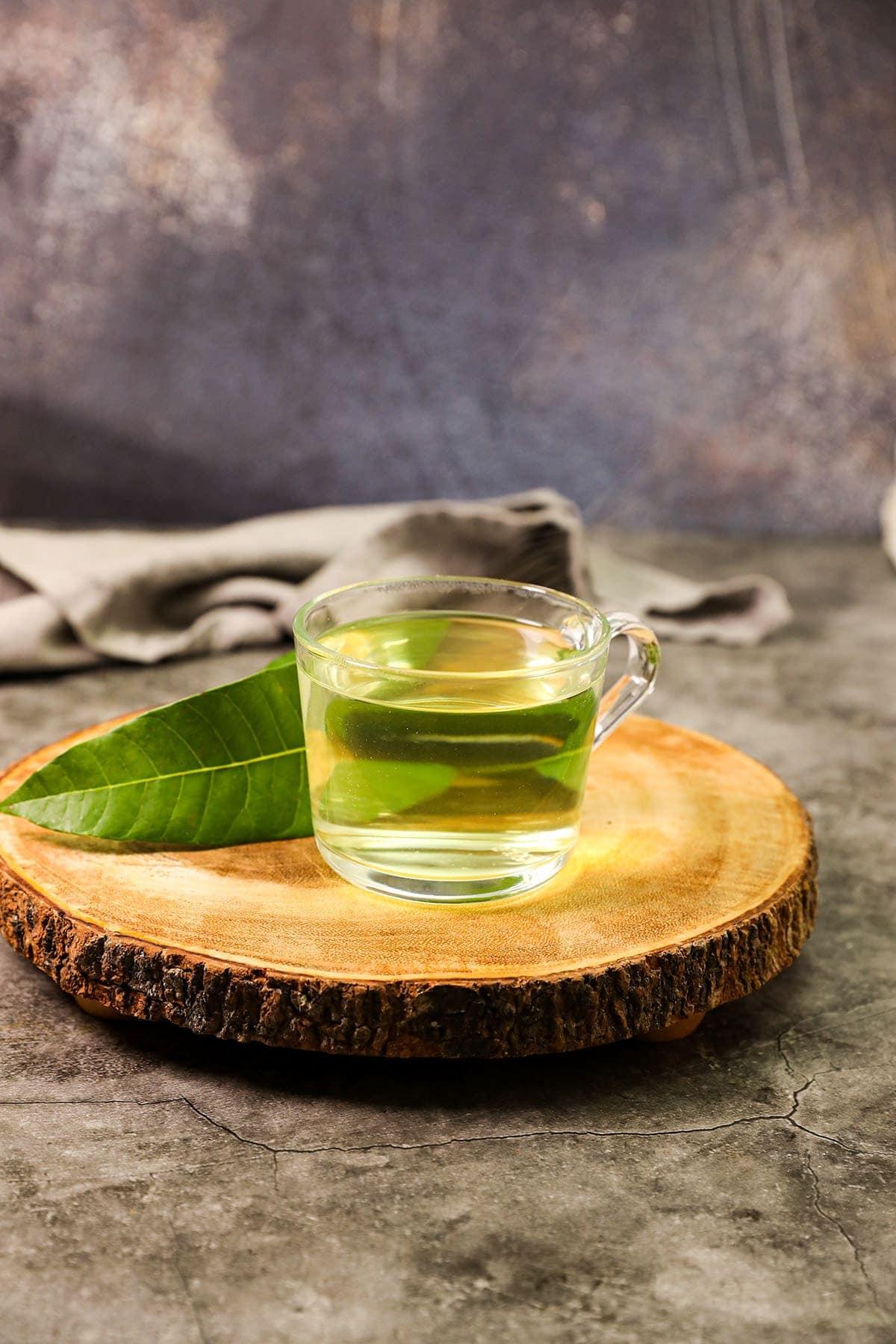 mango leaf tea in glass cup