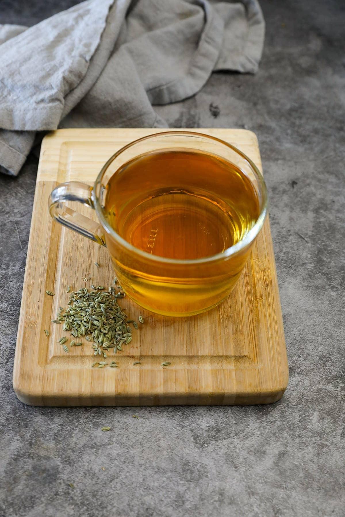 fennel seed tea on a wooden cutting board