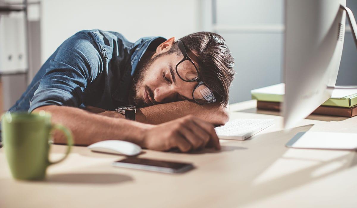 Man Sleeping In Office