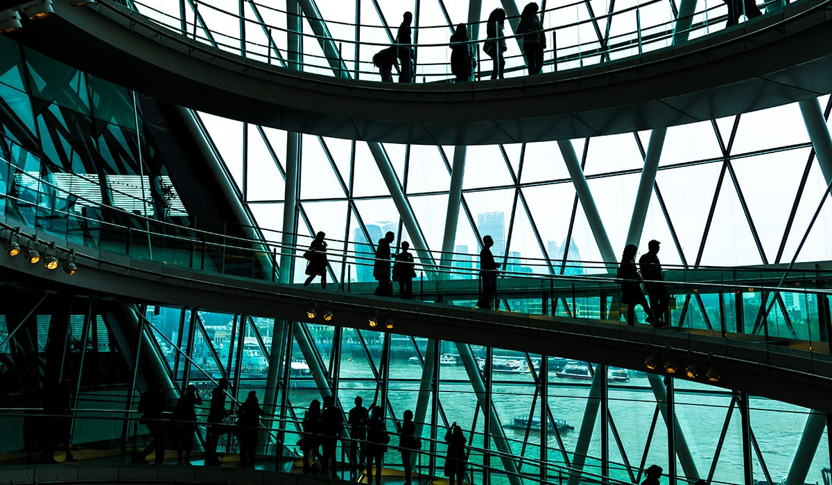 Abstract Modern Architecture And Silhouettes Of People On Spiral Staircase