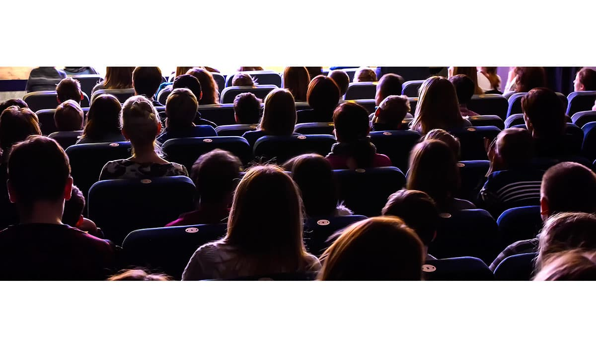 People In The Auditorium Watching The Performance