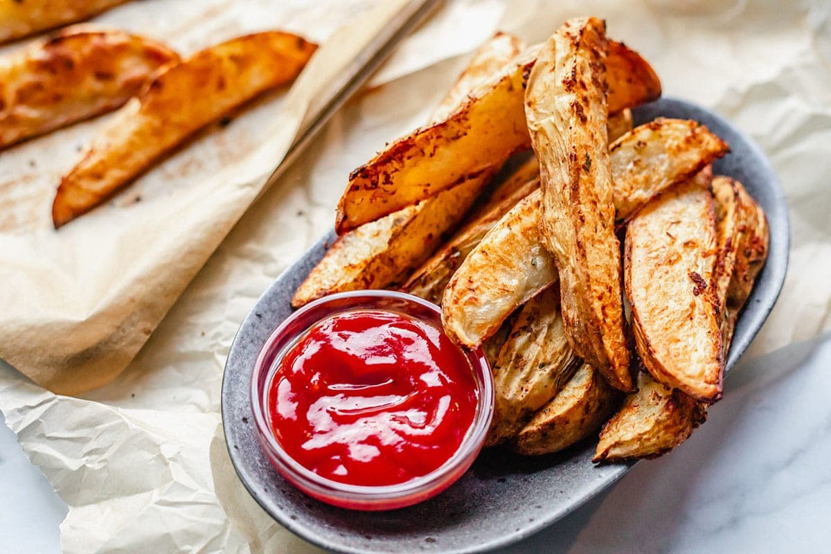 oven baked potato wedges on a grey plate