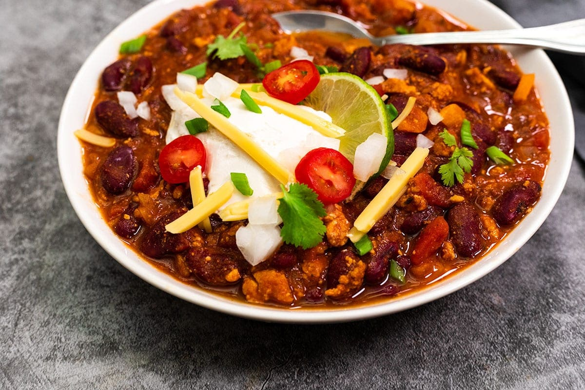 close up view of vegan chili in a white bowl