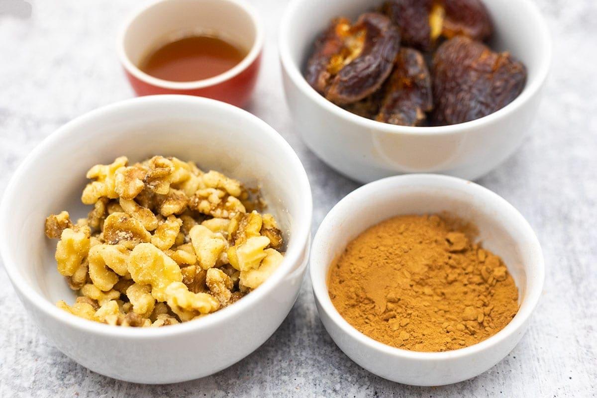 Carob truffles ingredients in white bowls
