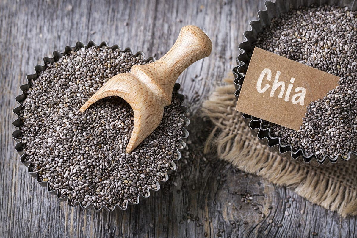chia seeds on wooden background in tart pans