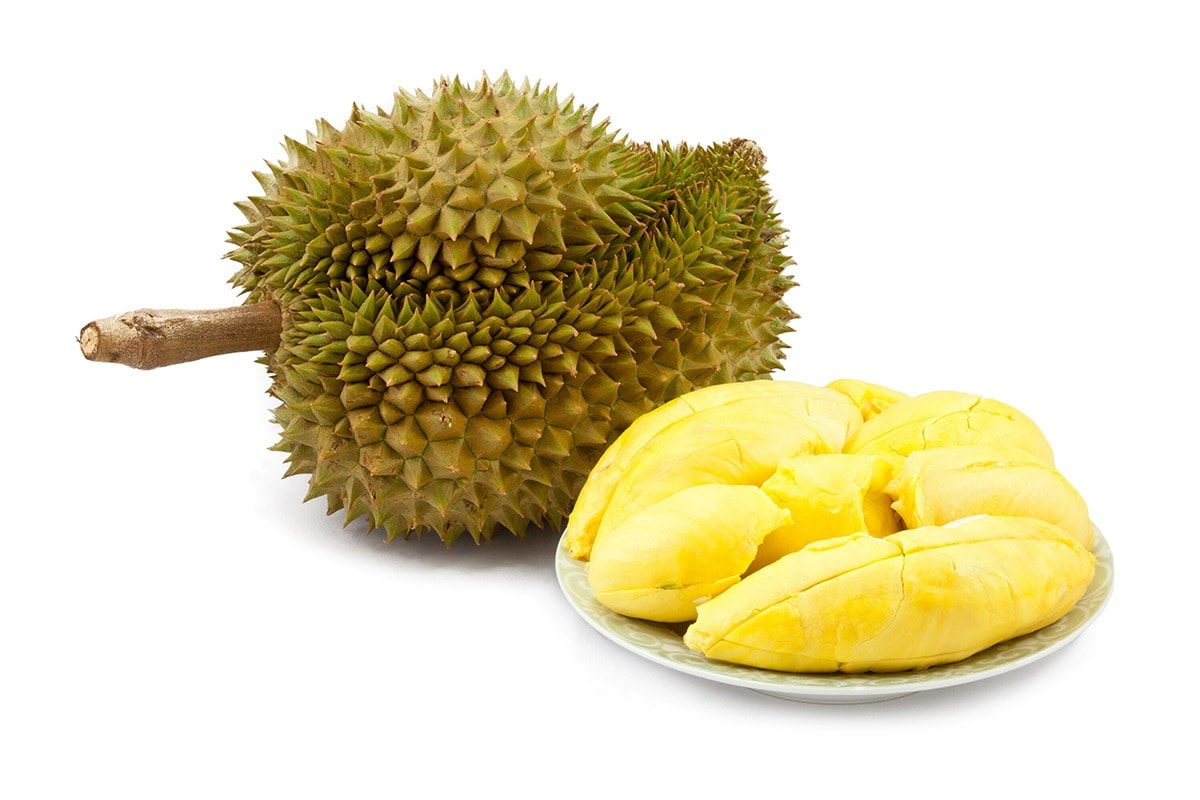 Durian fruit whole and shelled isolated on a white background