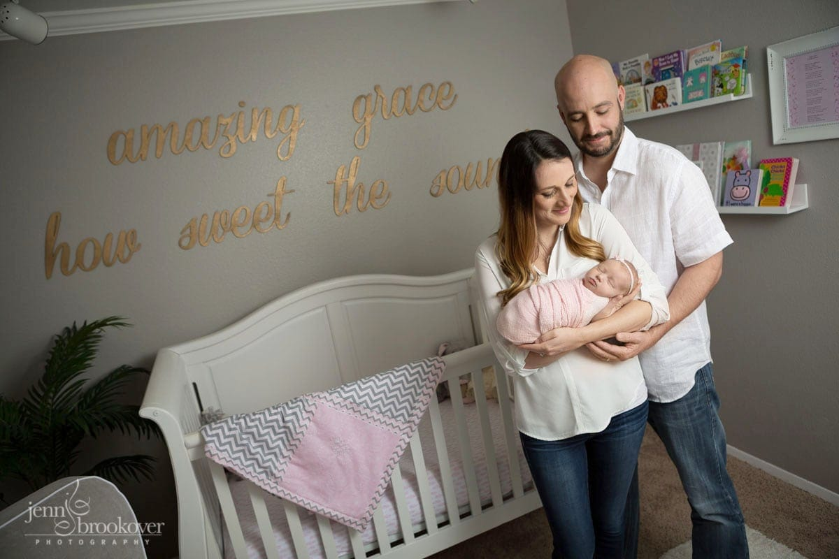 gorgeous newborn at home in San Antonio in her pink, gold and gray nursery with mom and dad by Jenn Brookover Photography