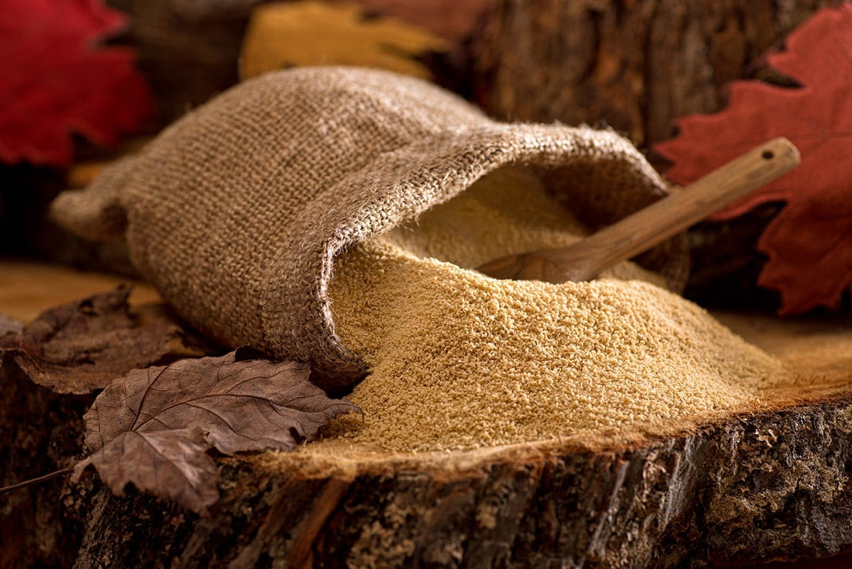 maple sugar in a brown sack on a wooden background