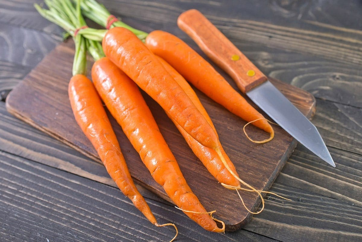 carrots on wooden cutting boad
