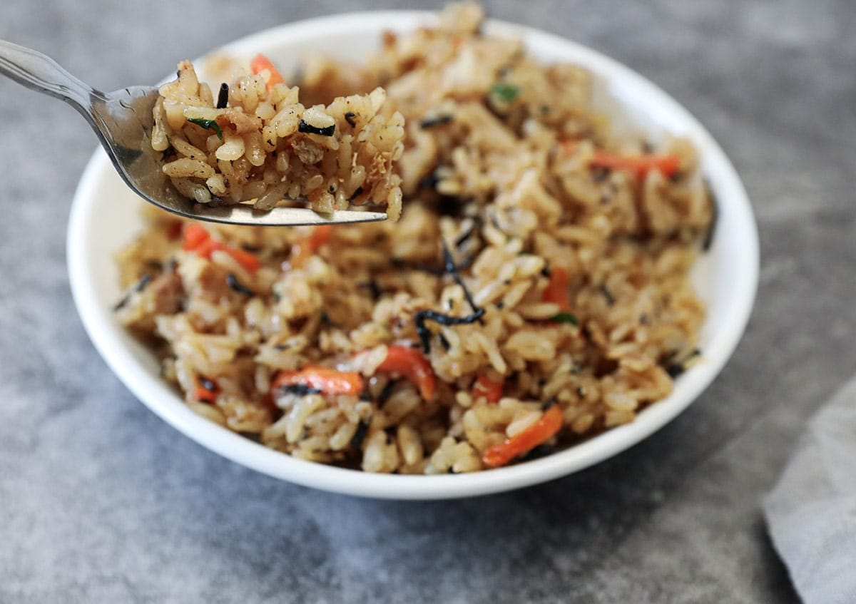 cooked hijiki fried rice in a white bowl on a grey background