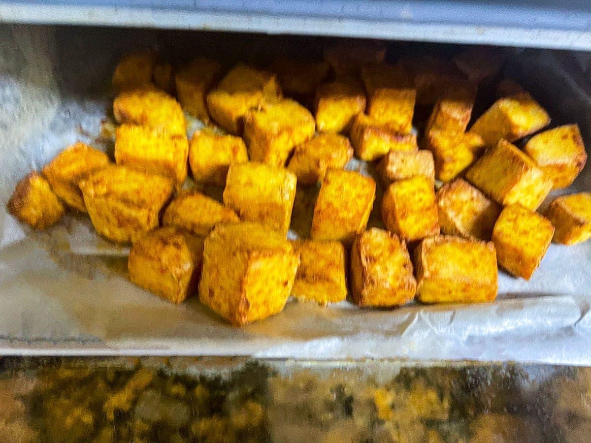 Air fryer tofu cubes in air fryer basket