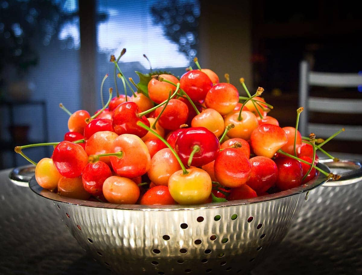 west indian cherry in a silver bowl on wooden background