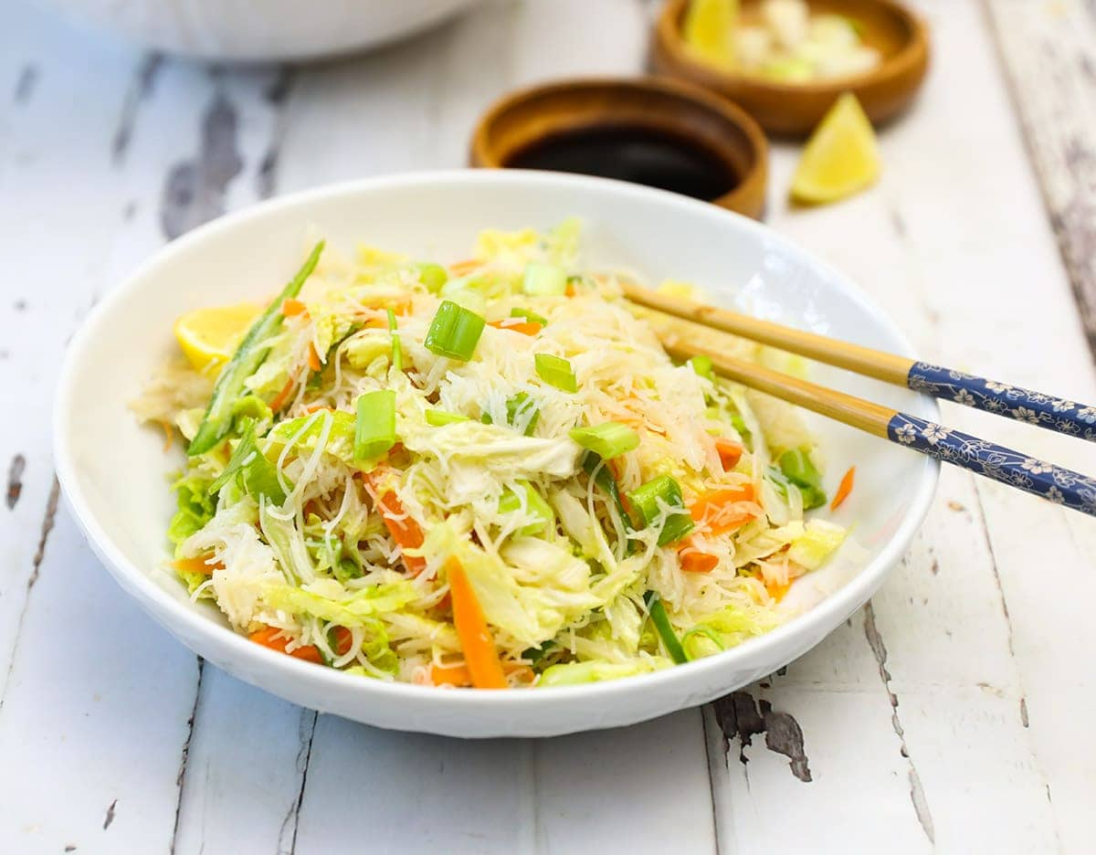 napa cabbage salad in white bowl close up