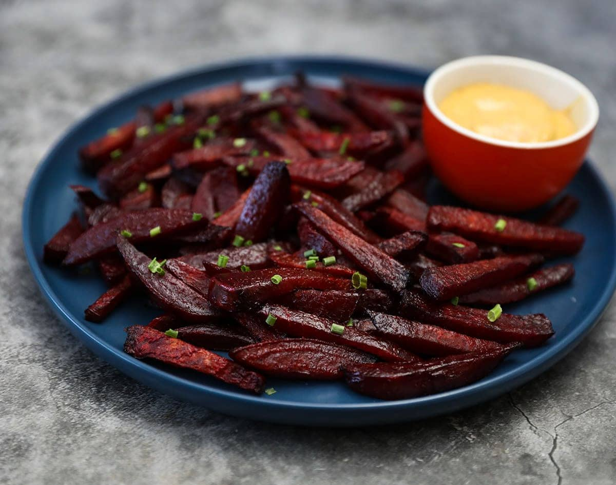 best beet fries on a blue plate on grey background