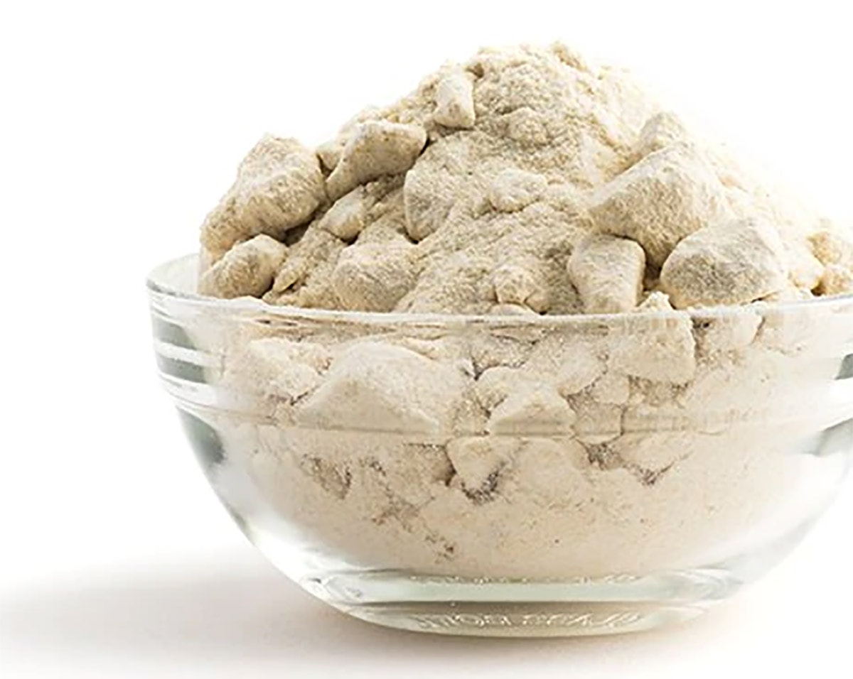 yacon sugar in a glass bowl on a white background