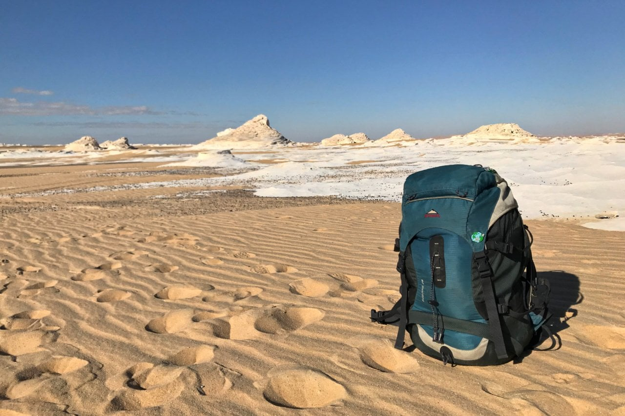 Backpack in the White Desert, Egypt - Experiencing the Globe