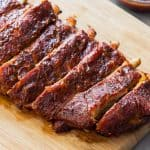 Rack of cut Instant Pot Ribs on a cutting board