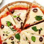Gluten Free Pizza on round wooden cutting board