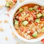 Top shot of creamy enchilada soup in a white bowl
