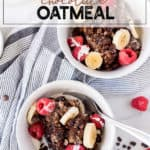 Two white bowls of chocolate oatmeal with bananas and berries