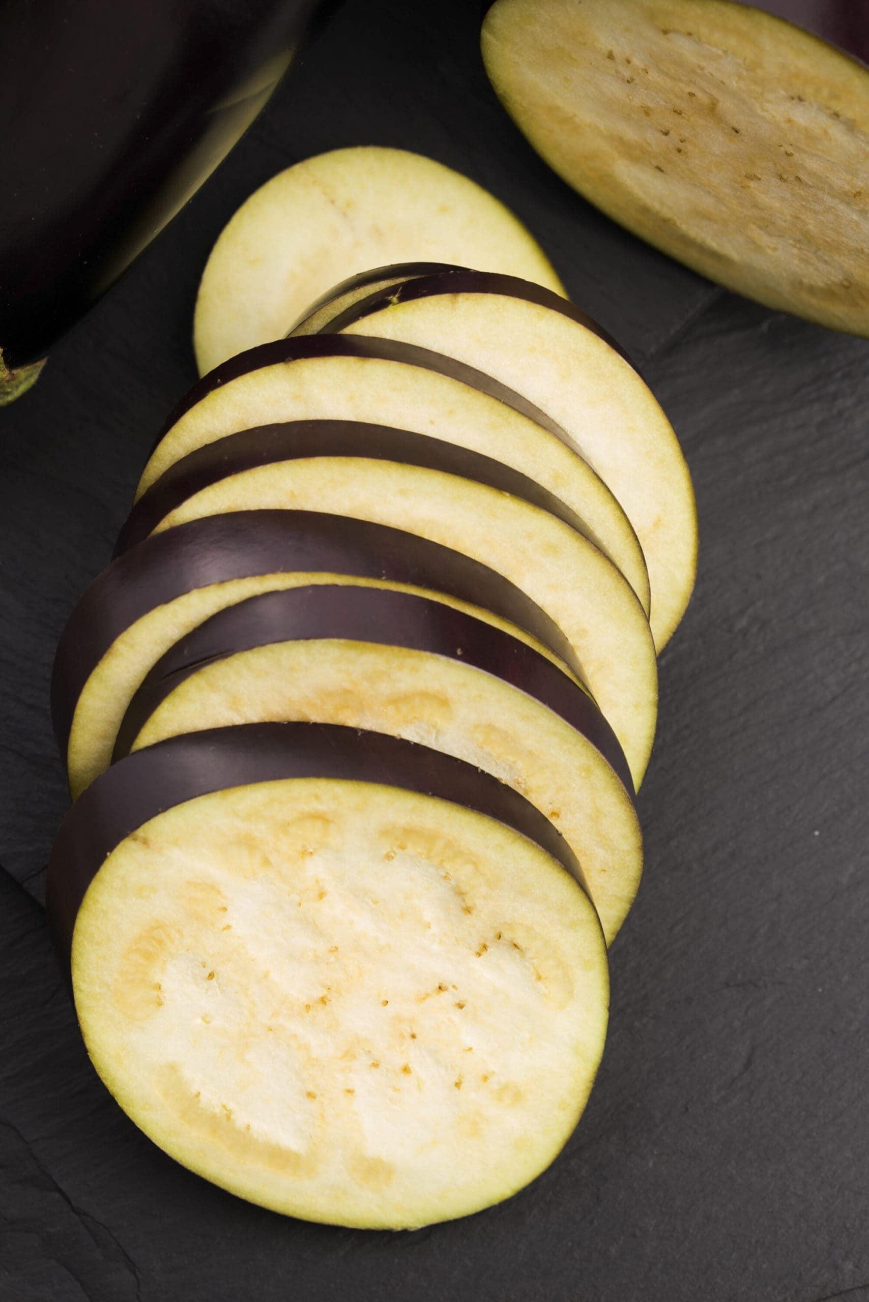 eggplant slices on a dark background