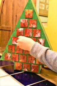 Wooden tree-shaped DIY Advent Calendar with child opening drawer