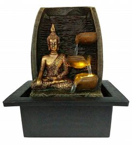 zen water feature with golden buddha statue
