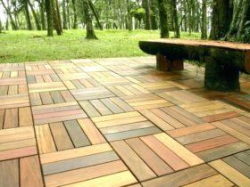 composite interlocking patio tiles on grass in the backyard