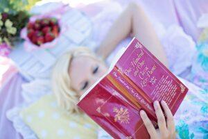 woman reading, love poem book, picnic