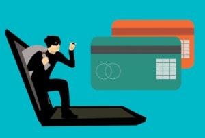 fraudster committing financial fraud via computer