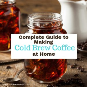 The Complete Guide to making COld Brew Coffee at Home with image of coffee in a mason jar over ice.