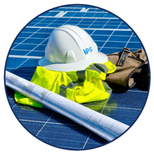 circle photo of hardhat and blue prints for solar panels
