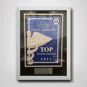 Top Plastic Surgeon 2021 · Dr. Cesar Aguiluz, DO