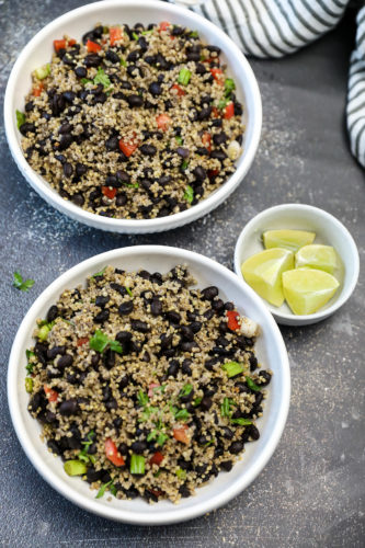 black bean millet overlay in two white bowl don a grey background