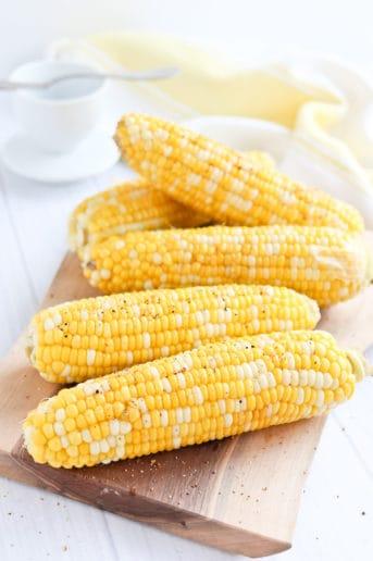 Corn on the cob on a wood cutting board