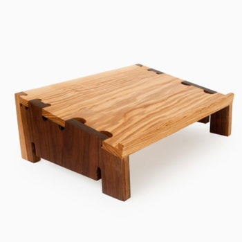 Laptop stand with Ash Top Walnut Sides, Solid wood pieces are connected with interlocking finger joints with contrasting colors.