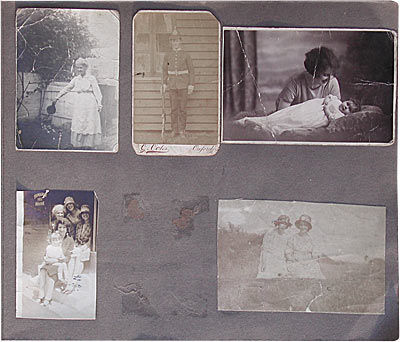 Old album page with black and white photos
