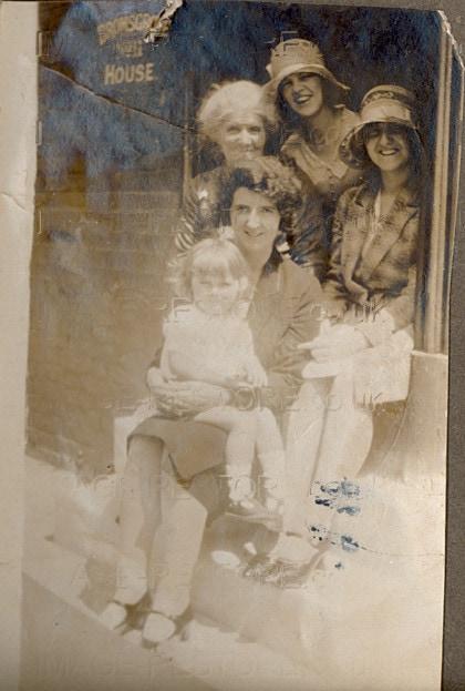Family portrait in doorway