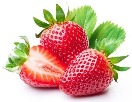 Strawberries in front of leaves on white bg