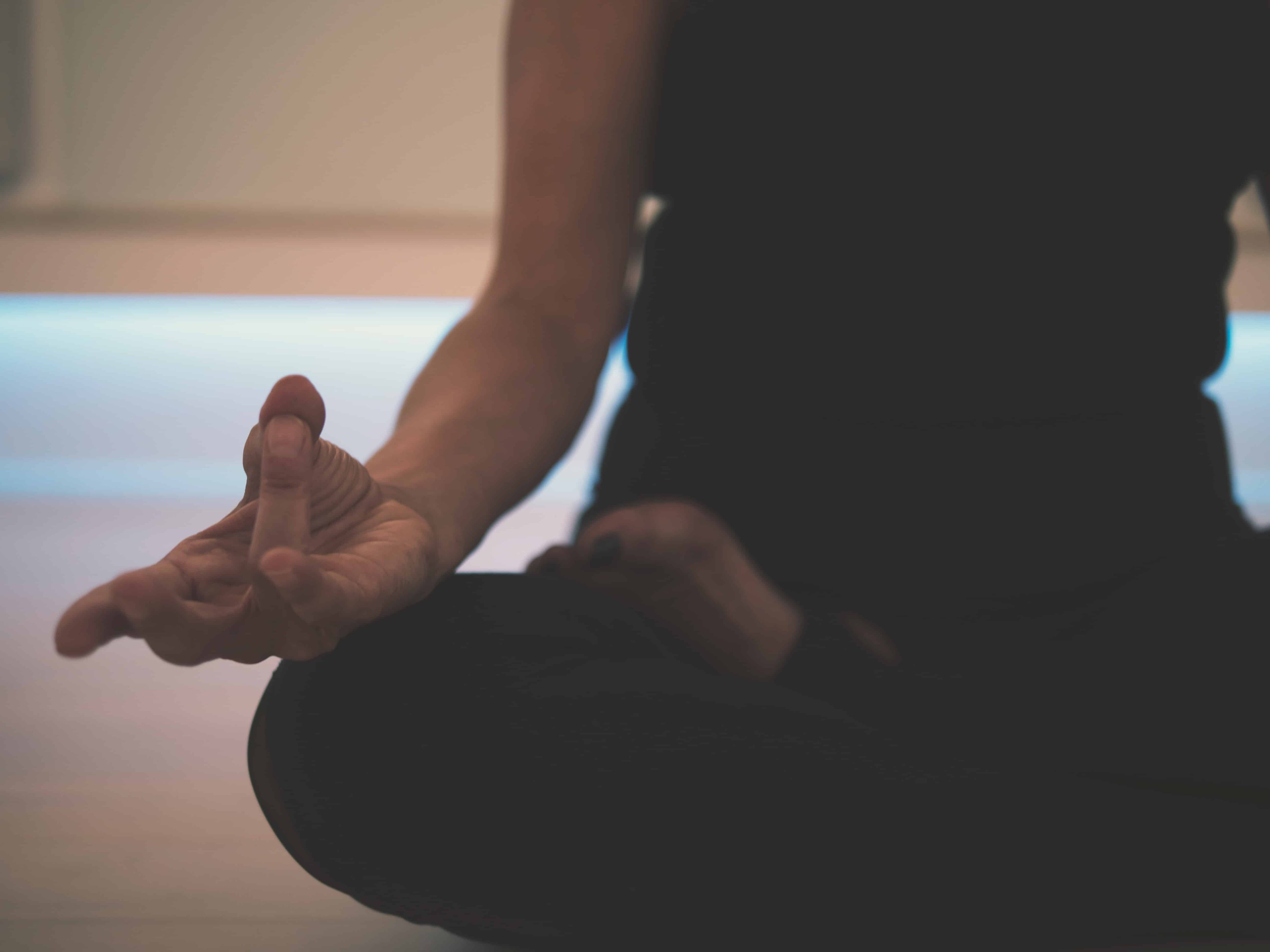 person sitting in meditation
