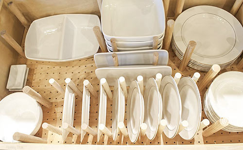 overhead view of custom peg drawer for dishes