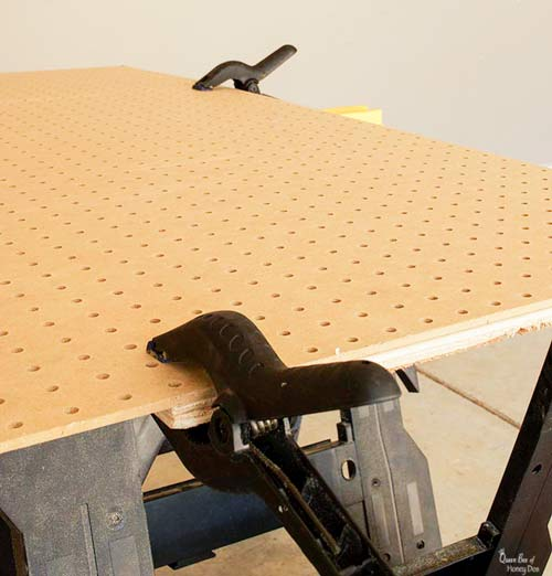 pegboard clamped to plywood