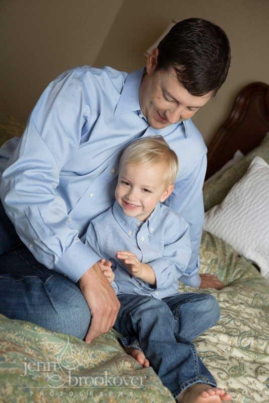 dad and son laughing during photo session at home