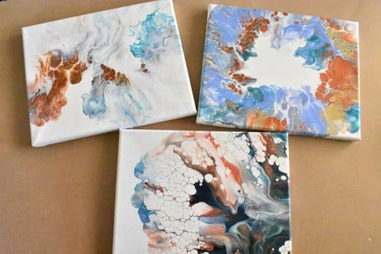three different types of dutch pour painting