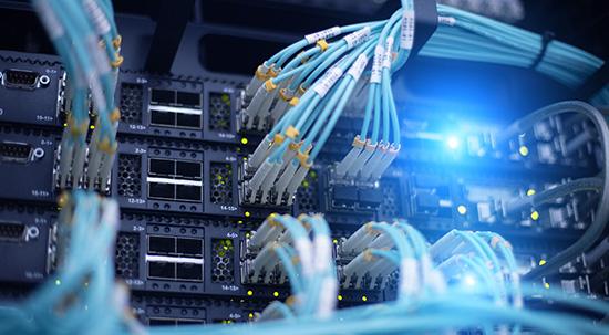 Light blue fiber optic cables in a data center server